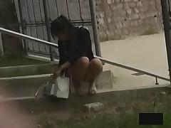 Last of the Asian girls bending over