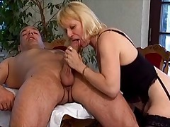 Blonde mature in black stockings in action