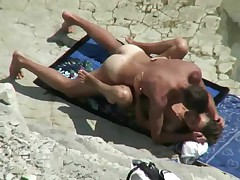 Couple spyed on a beach
