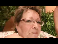 Chubby Granny in Glasses Takes on Two Crazy Cocks
