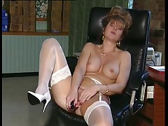British MILF slut Anna in an office scene