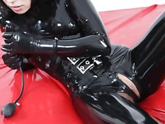 Sexy Mia masturbates with two inflatable dildos