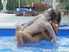 Sweet Lesbian Girlfriends Making Love In The Pool