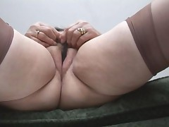 Busty Granny In Stockings Shows Off Plump Cameltoe And Hairy..