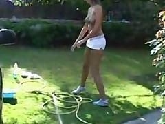 Hot Blonde Babe Washing The Car