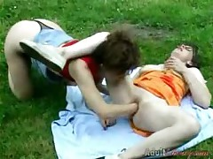 Two Lesbian Chicks Fisting In Garden