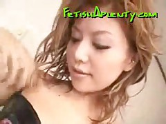 Hot Asian Chick With Stockings Gives A Nice Footjob