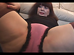 Busty mature with hairy pussy in mini skirt plays with