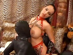 The gimp fucks her pussy in fetish video