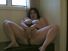 Lingerie BBW sits on big toy