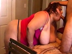 Big titted bbw chokes on a massive cock