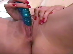 Gorgeous nylons model masturbates  solo