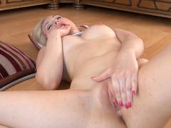Sweet blonde is posing her nice ass