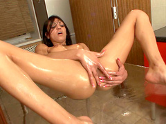 Pretty oiled brunette Malusha rubs her pussy