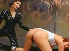 Hot redhead beauty is getting spanked by her sister