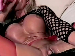 Slut with fake titties blows him