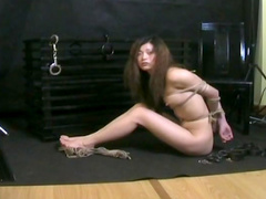 Sensual brunette being tied with force