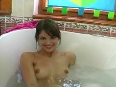 Stunning short-haired brunette smoke in the bath