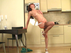 Sexy teen is posing naked in the kitchen