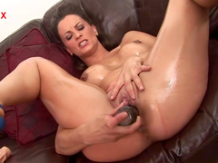 Brunette Valentina Cruz is poking her pussy with dildo