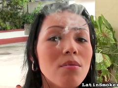 Smoking girl with soft lips