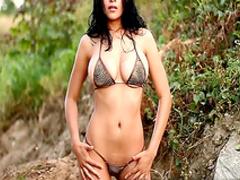 Busty girl wearing bikini gets naughty on the beach