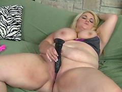 Fat blonde penetrates her vagina