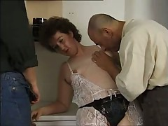 Mature lady in kitchen with two men