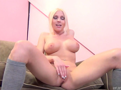 Tattooed blonde Christie Stevens is sucking a dick