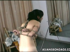Tied Asian babe being spanked with hardcore force