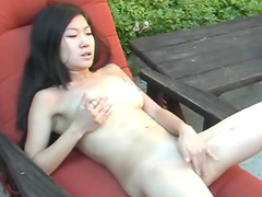 Nasty babe from Japan is masturbating her sexy pussy