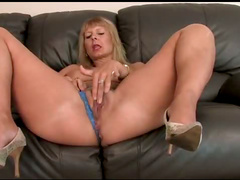 Foxy mature slow striptease