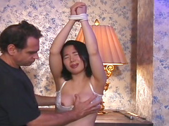 Tied Asian girl likes tit torture