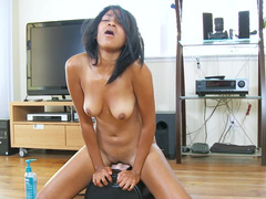 Tanned young Latina gets on the sybian fucking machine