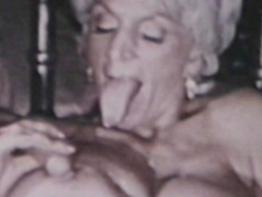 Old-fashioned mature making a titjob for her friend