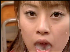 Alluring Asian babe is eating sperm with spoon