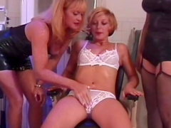 Two babes stimulate their friend's erogenous zones