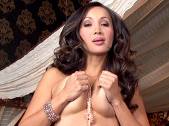 Glamour Asian babe Katsuni is posing in her stockings