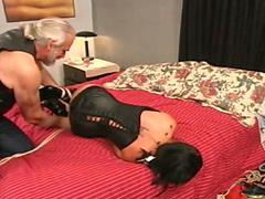 Hogtied Asian girl in corset
