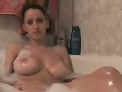 Busty Girl Masturbates In The Bath