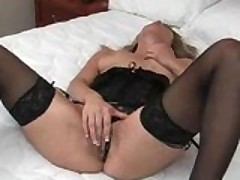 Self-Servicing Beauty On Bed