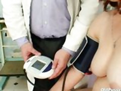 Mature Woman takes gyno exam at clinic