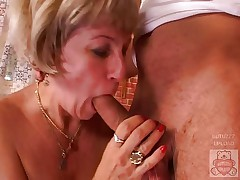 Mature mother and the Son's friend have a good time on kitchen.