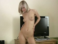 Cute Christina - Strips out of skinny jeans in front of TV