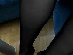 Woman plays in black pantyhose