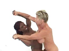 Nude Female Bodybuilders engaging in wrestling